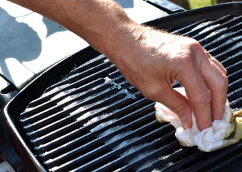 wiping the cast iron grill grates