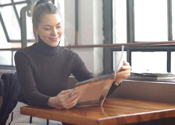 woman looking through menu