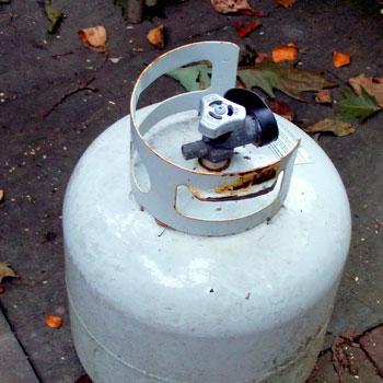 A white propane tank outdoors