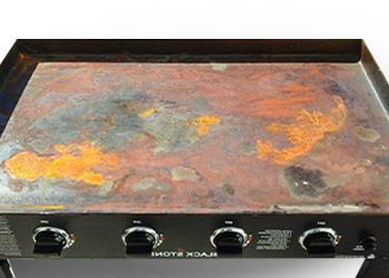 A griddle top full of rust