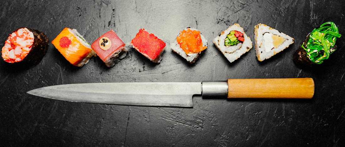 A sharp Japanese knife with assorted sushi