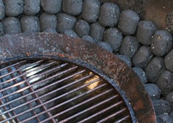 Charcoals surrounding the grill