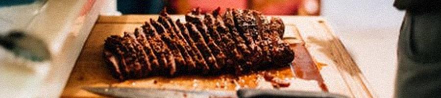 Sliced brisket on a chopping board
