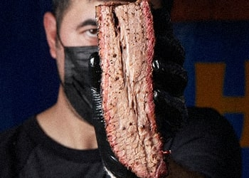A guy holding a brisket