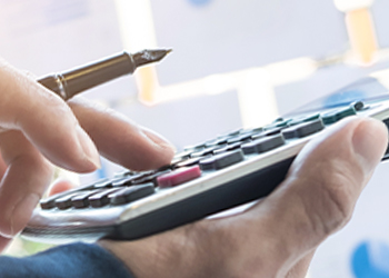 A person calculating the expenses