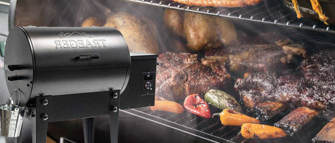 Traeger grill inside and outside with a lot of smoke