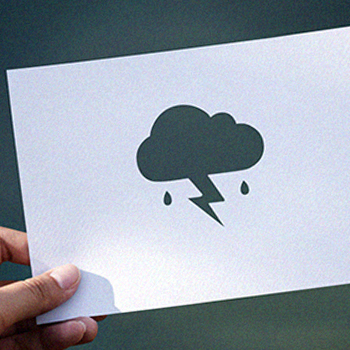 A paper cut out of a rainy weather symbol