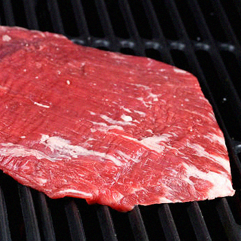 Flank steak on a grill