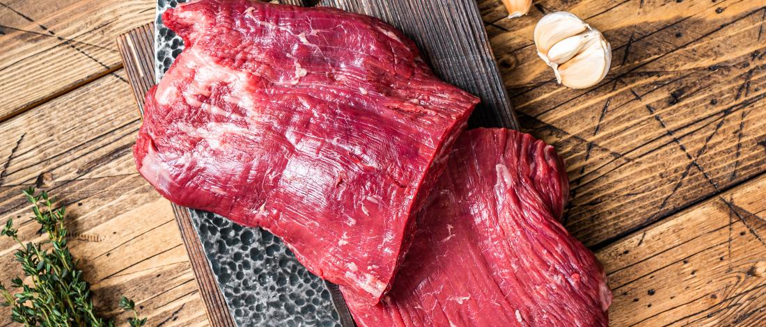 Flank steak on a cutting board